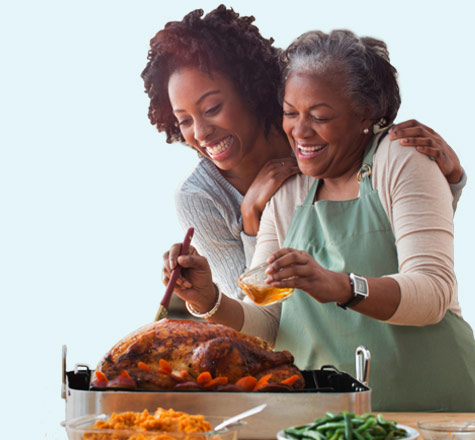 Mother and daughter preparing holiday meal